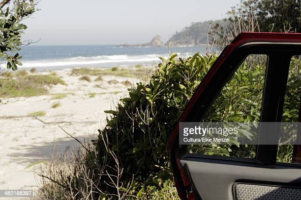 Open car door parked near beach