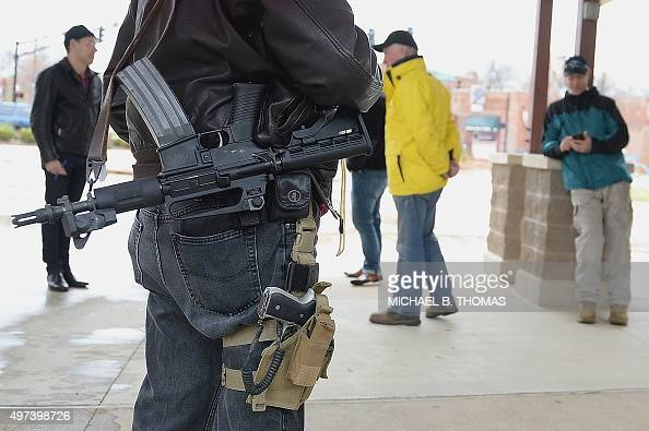 Open carry gun activists participate in a march on November 16 2015 in Ferguson Missouri About a dozen supporters of gun rights gathered in Ferguson...