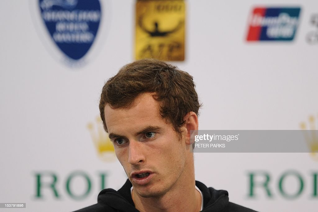 US Open champion Andy Murray of Britain attends a press conference at the Shanghai Masters tennis tournament in Shanghai on October 9, 2012. Murray admitted that winning his first Grand Slam had been a huge relief but said reaching the world number one ranking would be tough in an era of such intense competition. AFP PHOTO / Peter PARKS