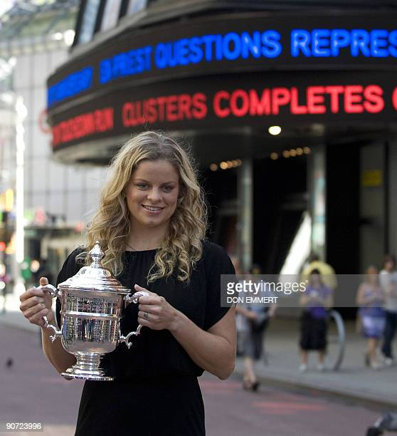US Open Champion Kim Clijsters poses with her trophy in Times Square after her victory against Caroline Wozniacki from Denmark during the Women's...