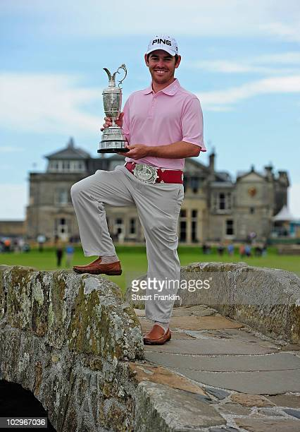 Open Champion Louis Oosthuizen of South Africa poses with the Claret Jug on the Swilken bridge on July 19 2010 in St Andrews Scotland