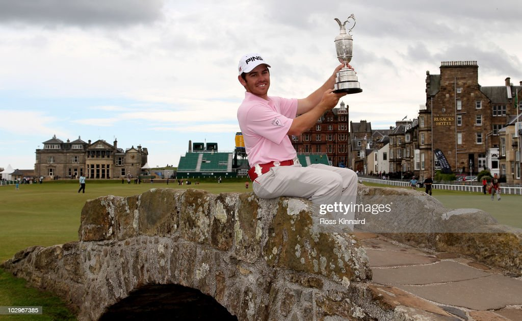 Open Champion Louis Oosthuizen of South Africa poses with the Claret Jug on the Swilken bridge on July 19, 2010 in St Andrews, Scotland