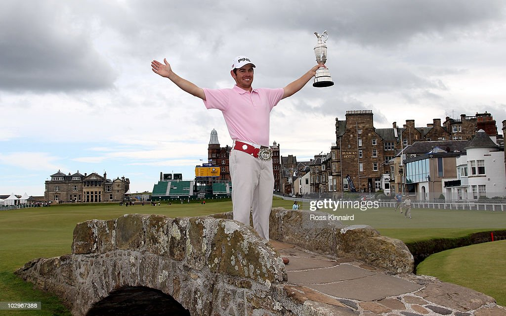 Open Champion <a gi-track='captionPersonalityLinkClicked' href=/galleries/search?phrase=Louis+Oosthuizen&family=editorial&specificpeople=241573 ng-click='$event.stopPropagation()'>Louis Oosthuizen</a> of South Africa poses with the Claret Jug on the Swilken bridge on July 19, 2010 in St Andrews, Scotland