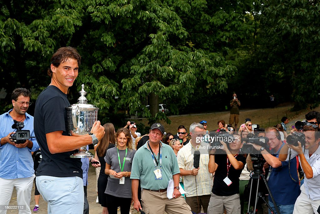 Open Champion <a gi-track='captionPersonalityLinkClicked' href=/galleries/search?phrase=Rafael+Nadal&family=editorial&specificpeople=194996 ng-click='$event.stopPropagation()'>Rafael Nadal</a> of Spain poses with the US Open Championship trophy in front of members of the media, following his victory in the men's singles final match against Novak Djokovic of Serbia, in Central Park on September 10, 2013 in New York City.