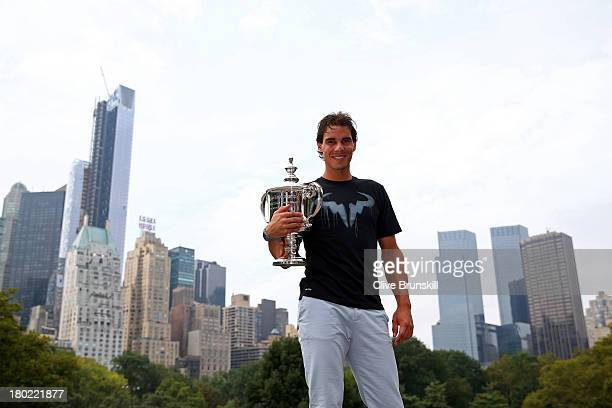 Open Champion Rafael Nadal of Spain poses with the US Open Championship trophy following his victory in the men's singles final match against Novak...