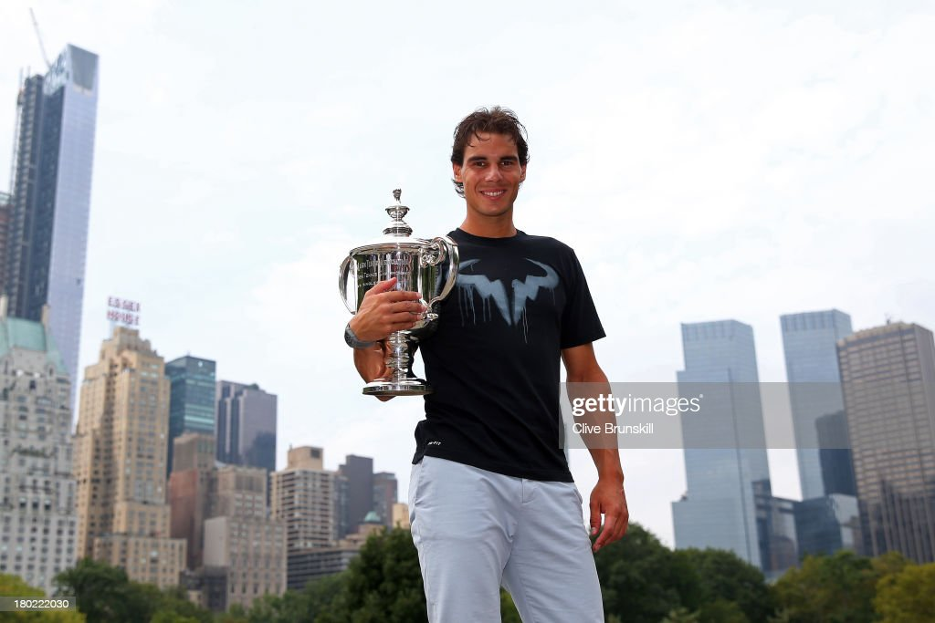 Open Champion <a gi-track='captionPersonalityLinkClicked' href=/galleries/search?phrase=Rafael+Nadal&family=editorial&specificpeople=194996 ng-click='$event.stopPropagation()'>Rafael Nadal</a> of Spain poses with the US Open Championship trophy, following his victory in the men's singles final match against Novak Djokovic of Serbia, in Central Park on September 10, 2013 in New York City.