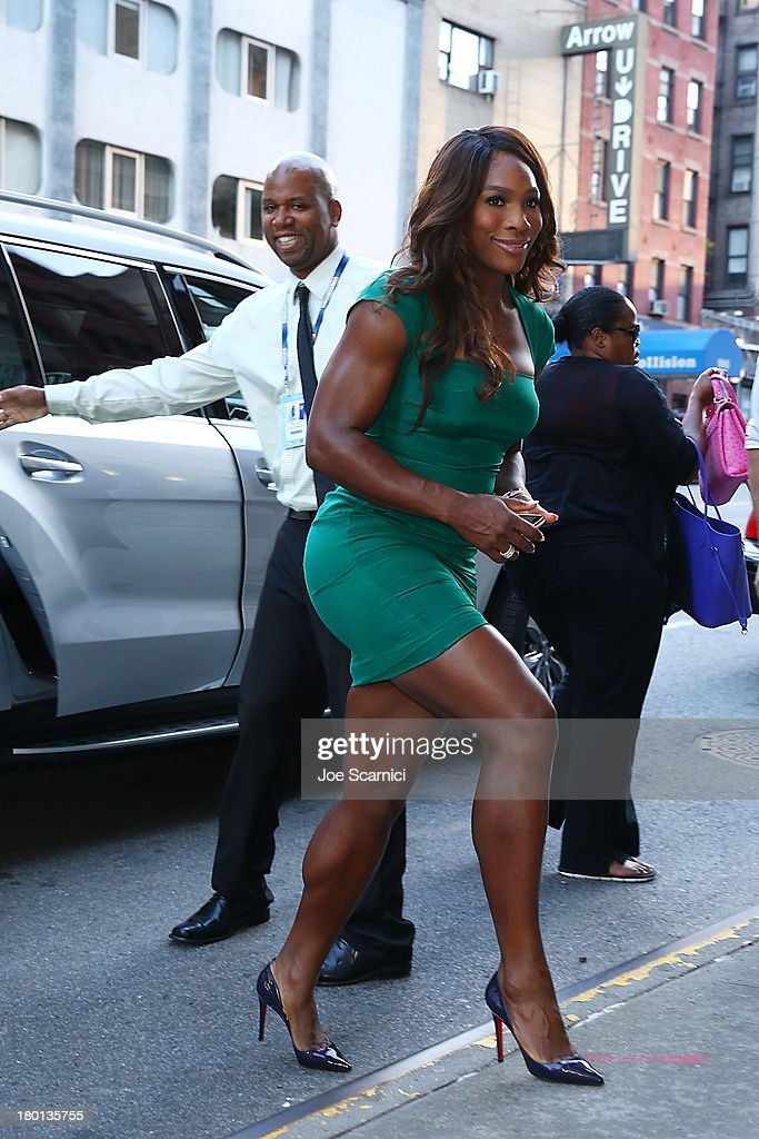 Open Champion <a gi-track='captionPersonalityLinkClicked' href=/galleries/search?phrase=Serena+Williams&family=editorial&specificpeople=171101 ng-click='$event.stopPropagation()'>Serena Williams</a> of the United States enters from the street to her appearace on the 'CBS This Morning' show on her New York City Trophy Tour on September 9, 2013 in New York City.
