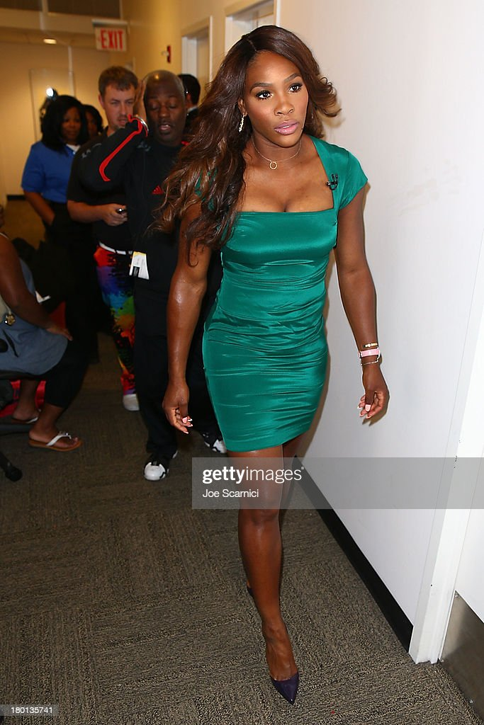 Open Champion <a gi-track='captionPersonalityLinkClicked' href=/galleries/search?phrase=Serena+Williams&family=editorial&specificpeople=171101 ng-click='$event.stopPropagation()'>Serena Williams</a> of the United States enters the building on her way to her appearance of 'Good Morning America' on her New York City Trophy Tour on September 9, 2013 in New York City.