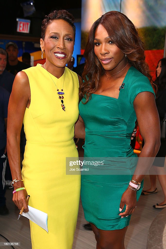 Open Champion <a gi-track='captionPersonalityLinkClicked' href=/galleries/search?phrase=Serena+Williams&family=editorial&specificpeople=171101 ng-click='$event.stopPropagation()'>Serena Williams</a> of the United States poses for a photo with TV Personality Robin Roberts backstage of the 'Good Morning America' show on her New York City Trophy Tour on September 9, 2013 in New York City.