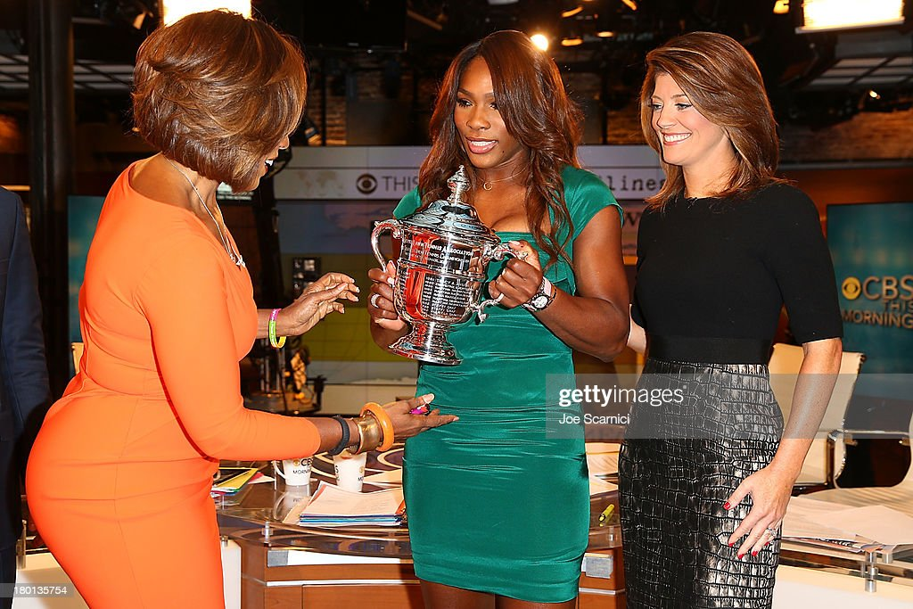 Open Champion <a gi-track='captionPersonalityLinkClicked' href=/galleries/search?phrase=Serena+Williams&family=editorial&specificpeople=171101 ng-click='$event.stopPropagation()'>Serena Williams</a> of the United States stops and chats on stage with 'CBS This Morning' stars Norah O'Donnell (R) and <a gi-track='captionPersonalityLinkClicked' href=/galleries/search?phrase=Gayle+King&family=editorial&specificpeople=215469 ng-click='$event.stopPropagation()'>Gayle King</a> (L) on her New York City Trophy Tour on September 9, 2013 in New York City.