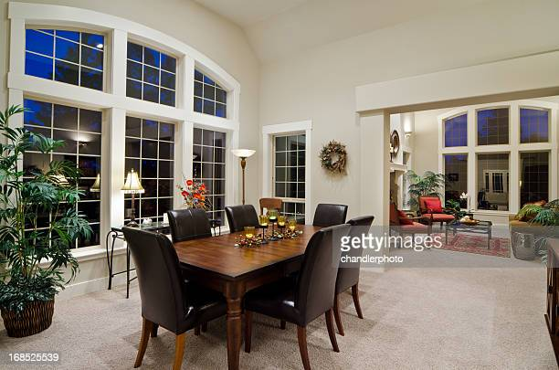Open concept dining room with brown chairs