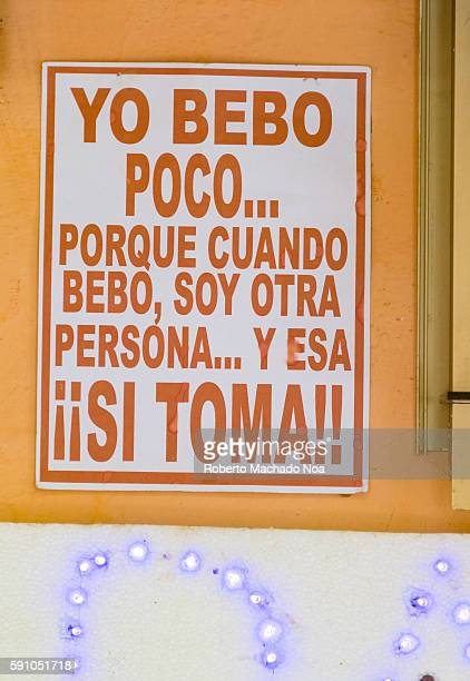 Open door bar in Maceo street with funny sign Getting alcoholic drinks in Cuba is easy and inexpensive so it is one of the successful industries in...