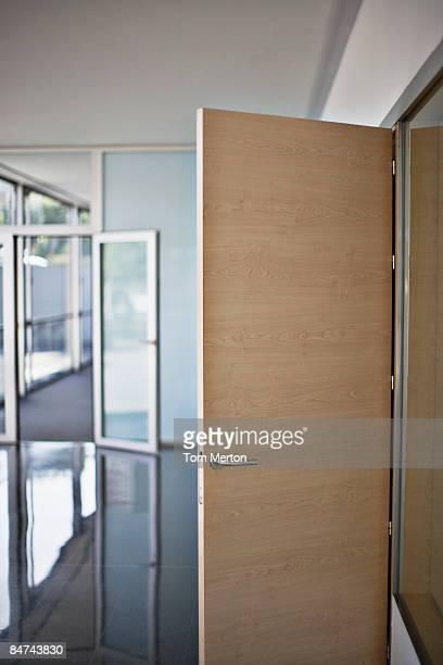 Open door in office building