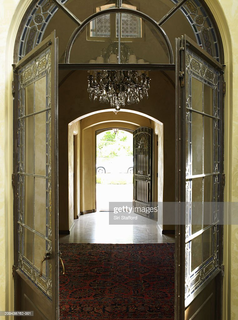 Open door leading to front entrance : Stock Photo