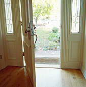 Open door of house, key in keyhole