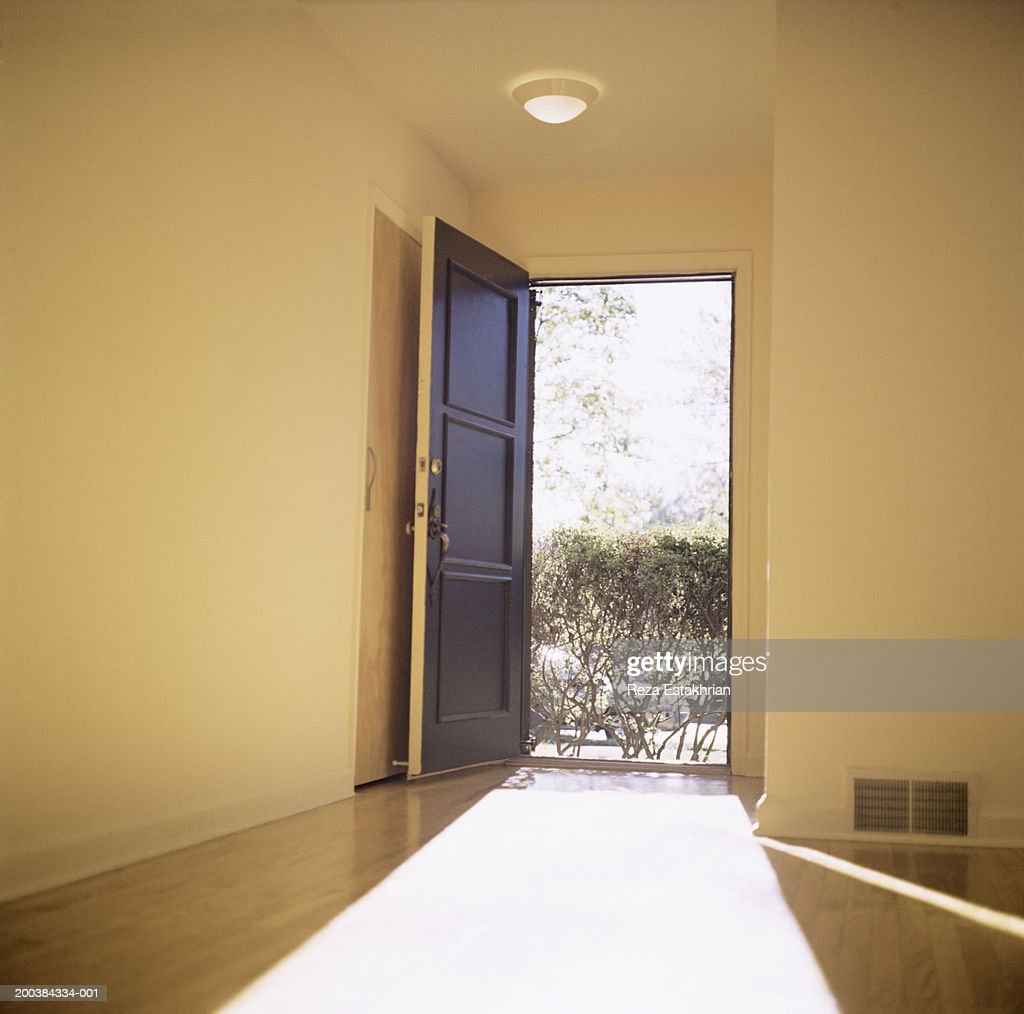 Open doorway with light flooding in : Stock Photo