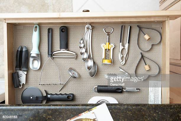 Open drawer with assorted kitchen tools