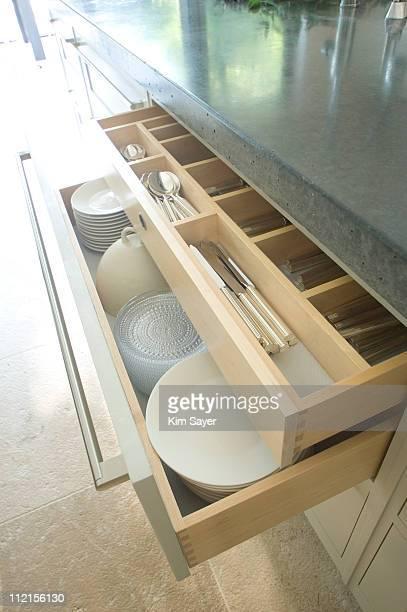 Open drawers in modern kitchen