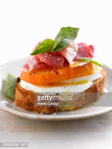 ... With Mozzarella Tomato Basil And Prosciutto Stock Photo | Getty Images