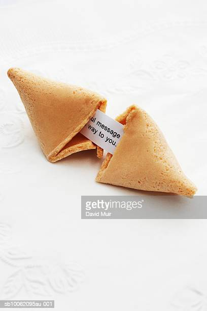 Open fortune cookie with message, close-up