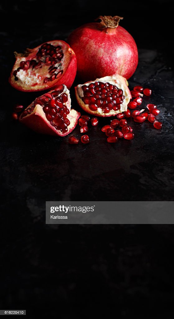 Open fresh ripe pomegranates : Stock Photo