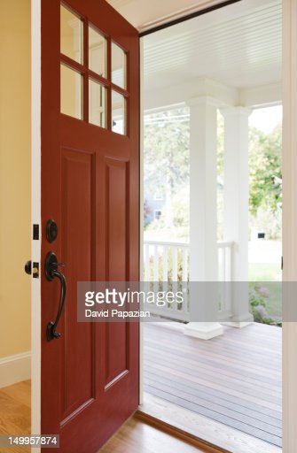 Open Front Door From Inside open front door of a new home from the inside stock photo | getty
