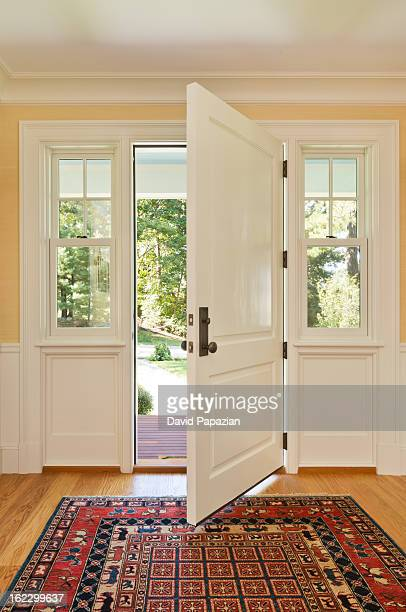 Open front door of custom bulit home
