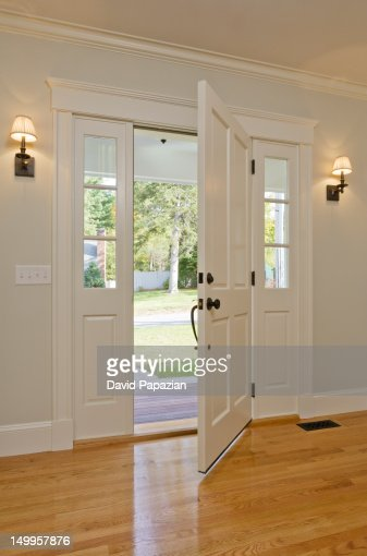 open front door of home seen from inside stock photo