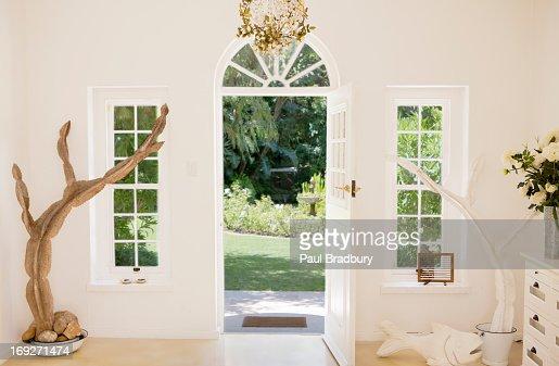 Open front door of modern house