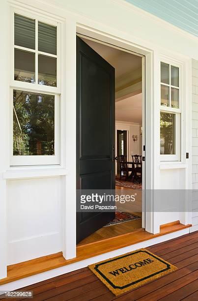 Open front door of newly built home