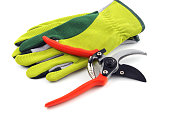 Open gardening shears and gloves