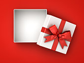 Open gift box , present box with red ribbon bow and blank space in the box isolated on red background with shadow . 3D rendering.