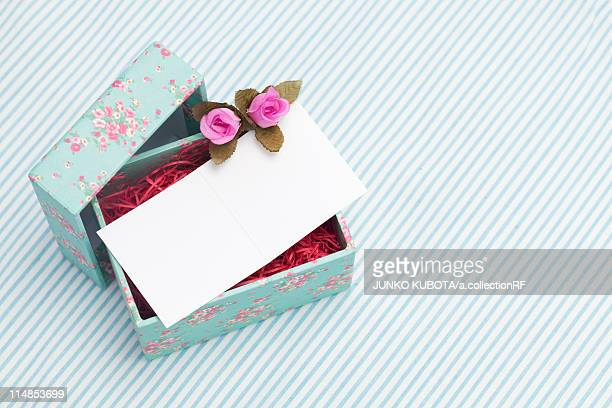 Open gift box with blank greeting card