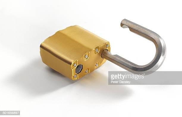 Open gold padlock