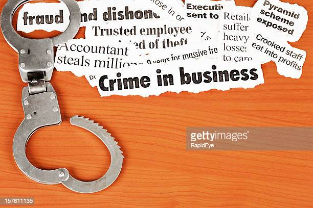 Open handcuffs emphasise 'fraud' in headlines on white collar crime