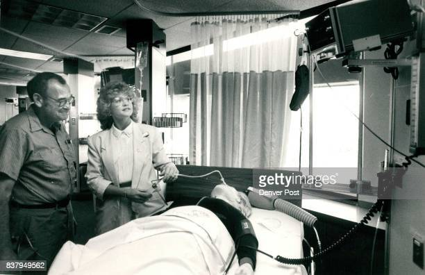Open House 'Coronary Care Unit Opens with state of the art equipment' 6 bed unit Shot of the head nurse Nancy Golden MICUCCU showing James Spurlock a...