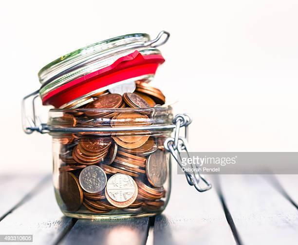 Open jar of coins