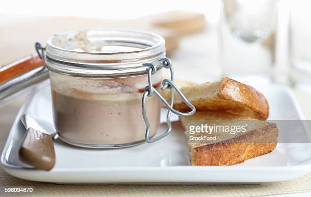 Open Jar of Homemade Duck and Mushroom Pate with Toasted Bread