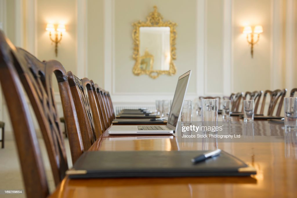 Open laptop on meeting table : Stock Photo