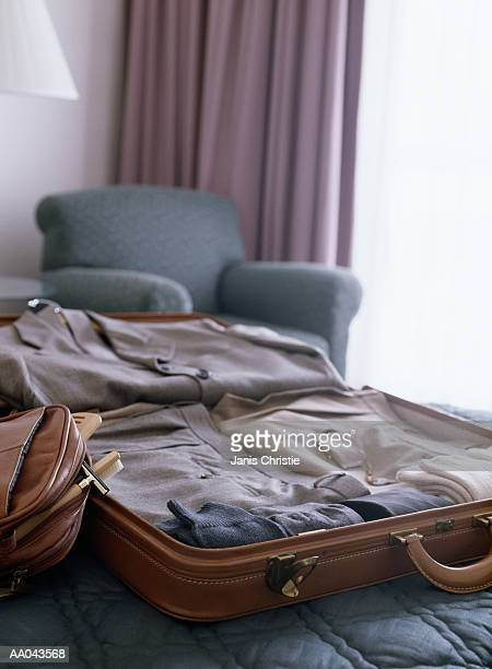 Open Luggage on Hotel Bed