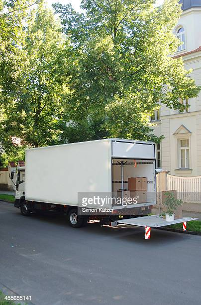Open moving truck with packing cases