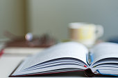 Close up of open notebook blurred with very shallow depth of field