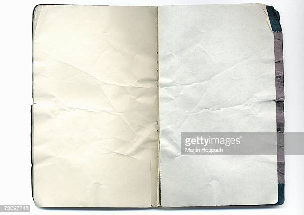 Open notebook with crumpled pages