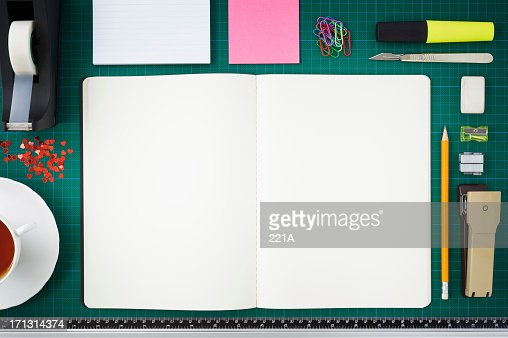 Open notebook/scrapbook and paraphernilia