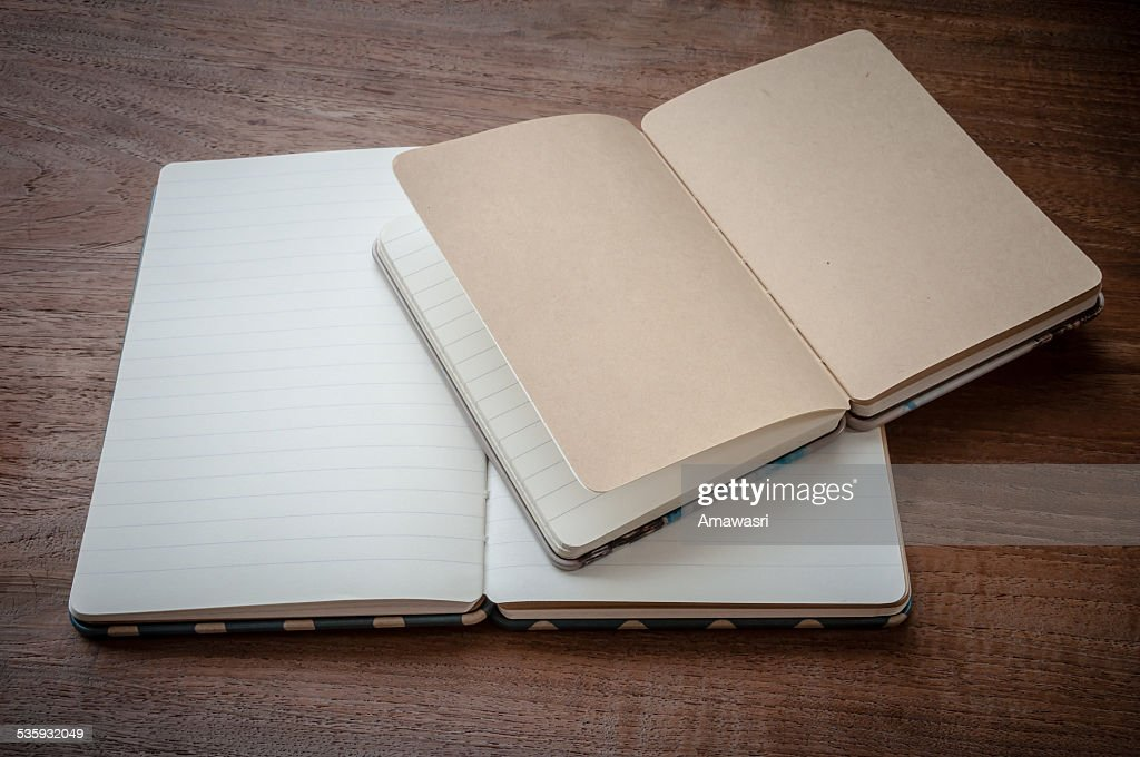open old book on wooden background : Stock Photo