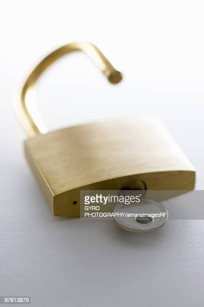 Open padlock with key