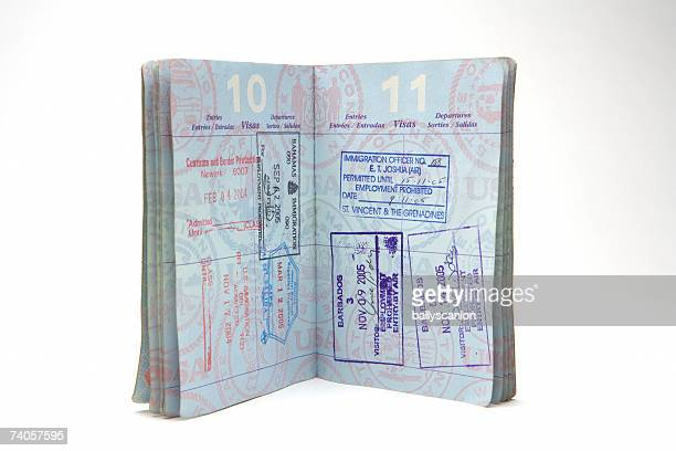 Open passport with stamps on white background