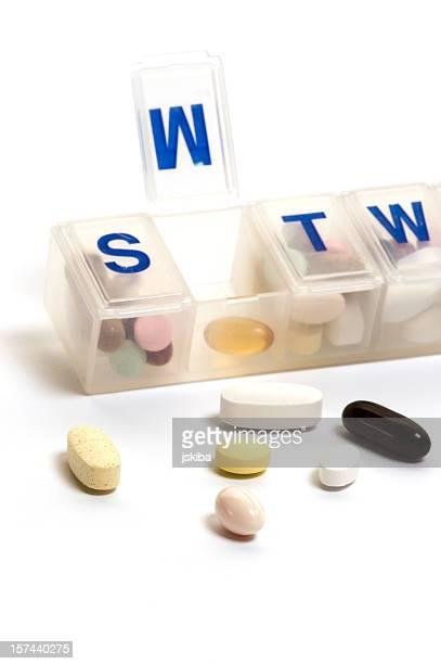 Open pill organizer with pills