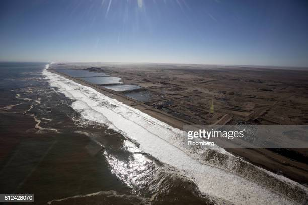 Open pit diamond mines operated by De Beers sit close to the Atlantic shoreline on the Skeleton Coast off the coast of Namibia on Friday June 16 2017...