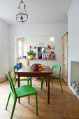 Open plan kitchen diner with table and chairs
